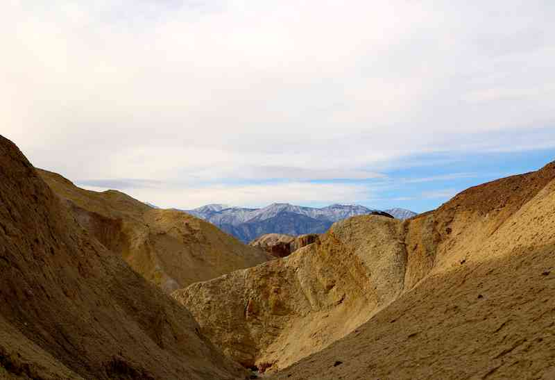 Snow-capped peaks behind the Death Valley desert