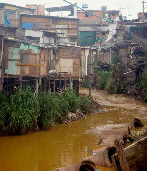 Polluted water running through the favela