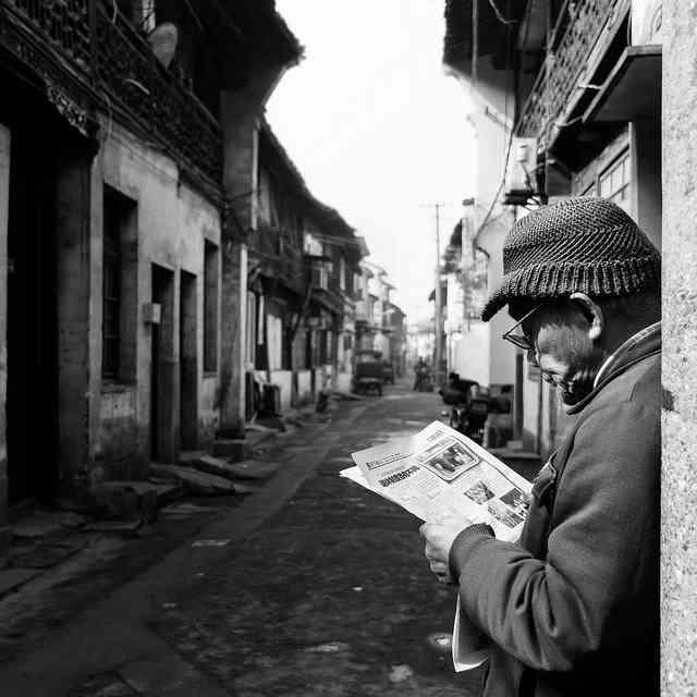 Chinese Man Newspaper
