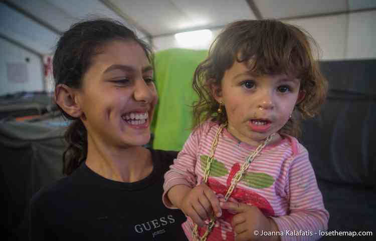 Dirty Face and smiles in the refugee camp