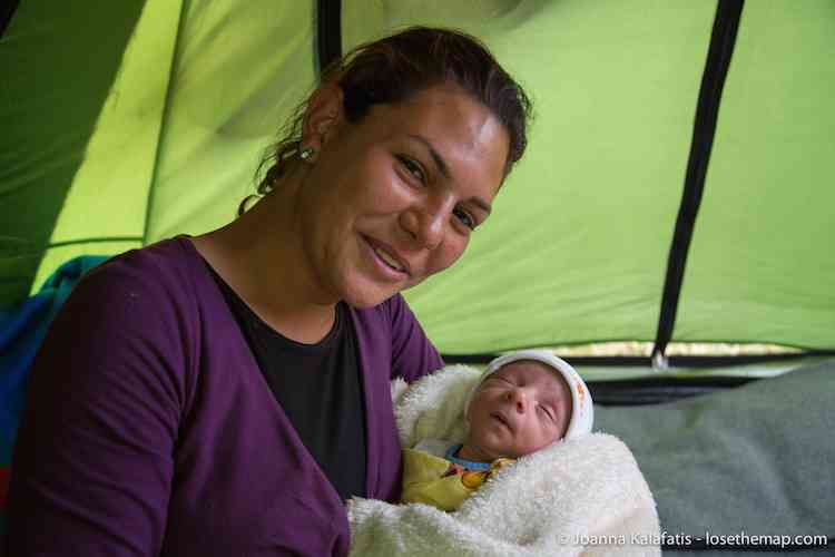 Namaya with her 8-old day newborn, born in the refugee camp.